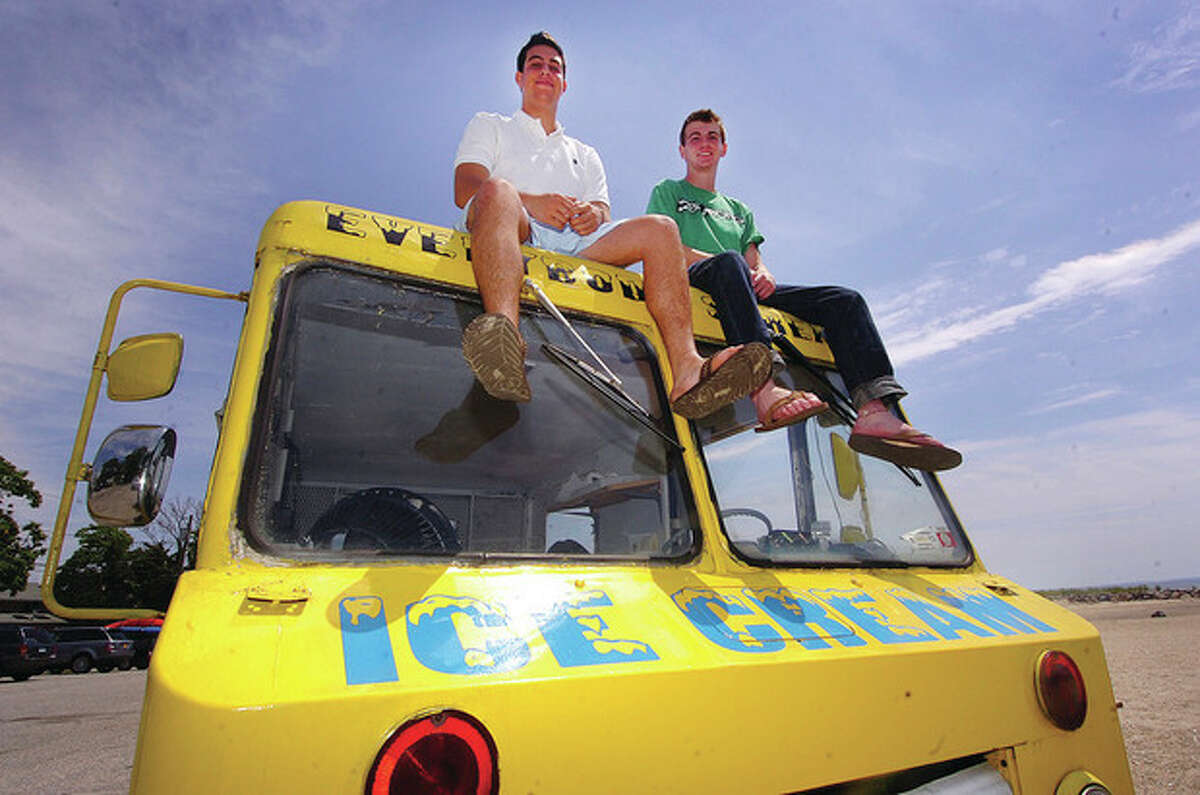 """Hour photo / Alex von Kleydorff From left, Jon Camche and Rick Snyder perch atop their """"Everybody Scream! Ice Cream"""" truck in Westport. The two teenage friends pooled their resources and started a summer business."""