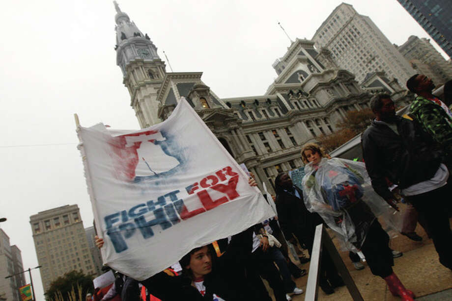 Marchers from the encampment at City Hall head to the offices of Sen. Pat Toomey, R-Pa., Thursday, Oct. 13, 2011 in Philadelphia. The encampment at City Hall is one of many being held across the country recently in support of the ongoing Occupy Wall Street demonstration in New York. (AP Photo/Alex Brandon) / AP