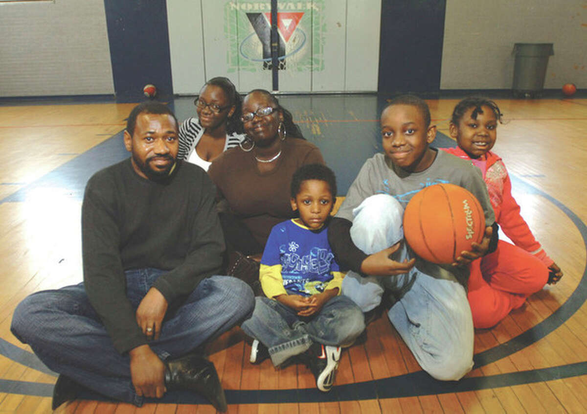 Hour photo / Erik Trautmann Geraine Anthony is shown with his family -- daughter Ashani Sims,13, wife Amber Anthony, son Jayden Sims, 4, son Jhani Sims, 11, and daughter Heavenly Sistrunk, 8. The family met at the Open Door Shelter and participated in the Allen Houston F.I.S.L.L. program at the Norwalk YMCA recently.