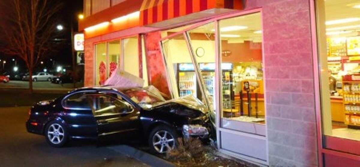 Car smashes through Dunkin Donuts in Norwalk, two patrons injured