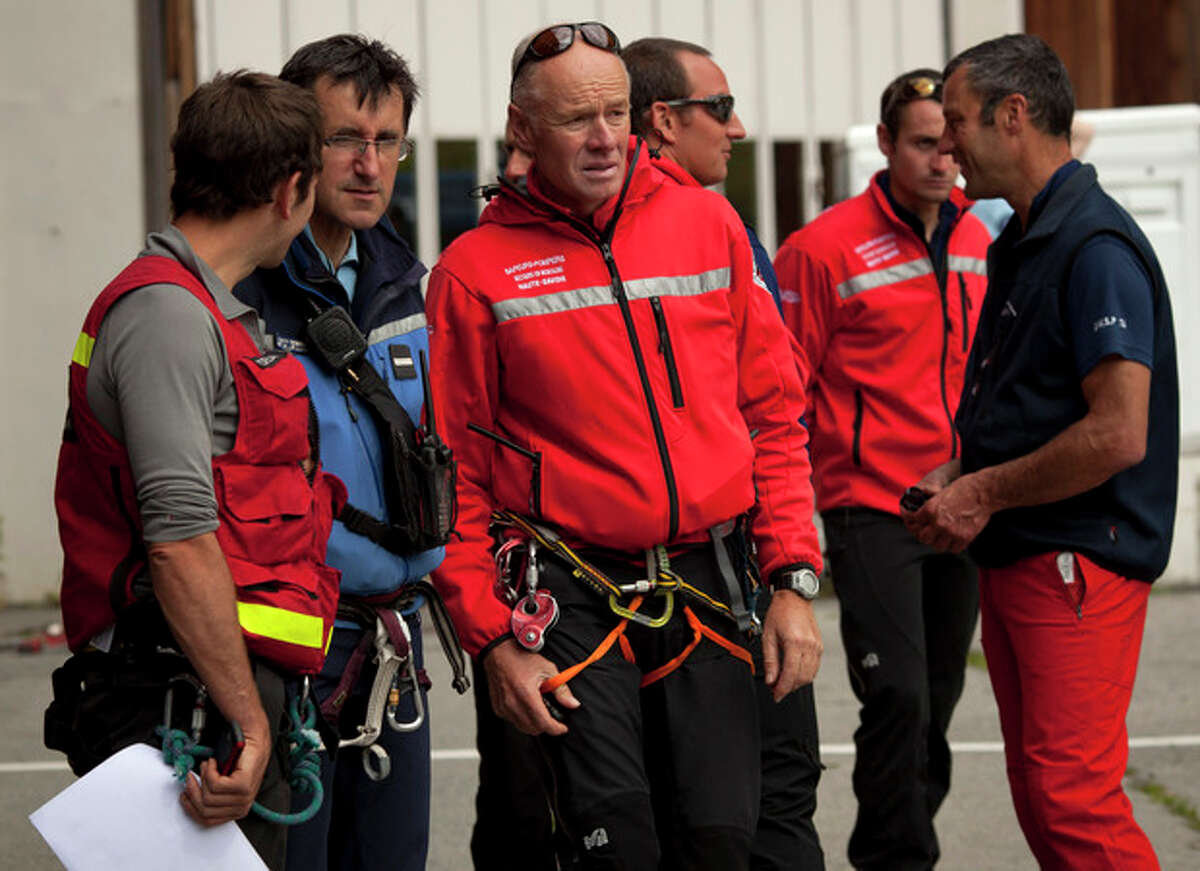 French rescuers arrive at a helicopter landing area after an avalanche in the French Alps near Chamonix, France, swept at least nine climbers to their deaths, Thursday, July 12, 2012. About 28 climbers from Switzerland, Germany, Spain, France, Denmark and Serbia were believed to be involved in the expedition caught in the avalanche, according to the local gendarme service and Danish Foreign Ministry. (AP Photo/Anja Niedringhaus)