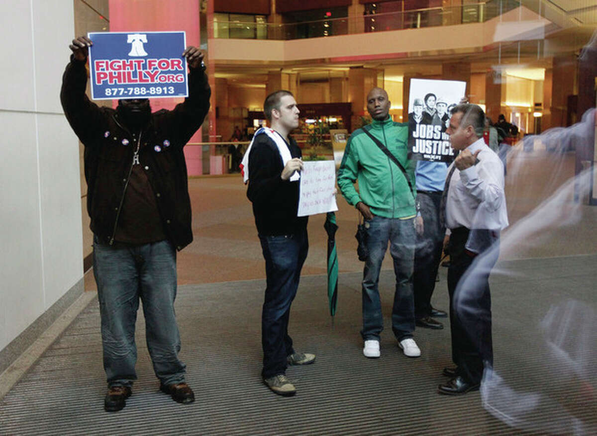 Marchers from the encampment at City Hall are told to leave inside the lobby of a building that houses a Wells Fargo Bank, Thursday, Oct. 13, 2011 in Philadelphia. The encampment at City Hall is one of many being held across the country recently in support of the ongoing Occupy Wall Street demonstration in New York. (AP Photo/Alex Brandon)