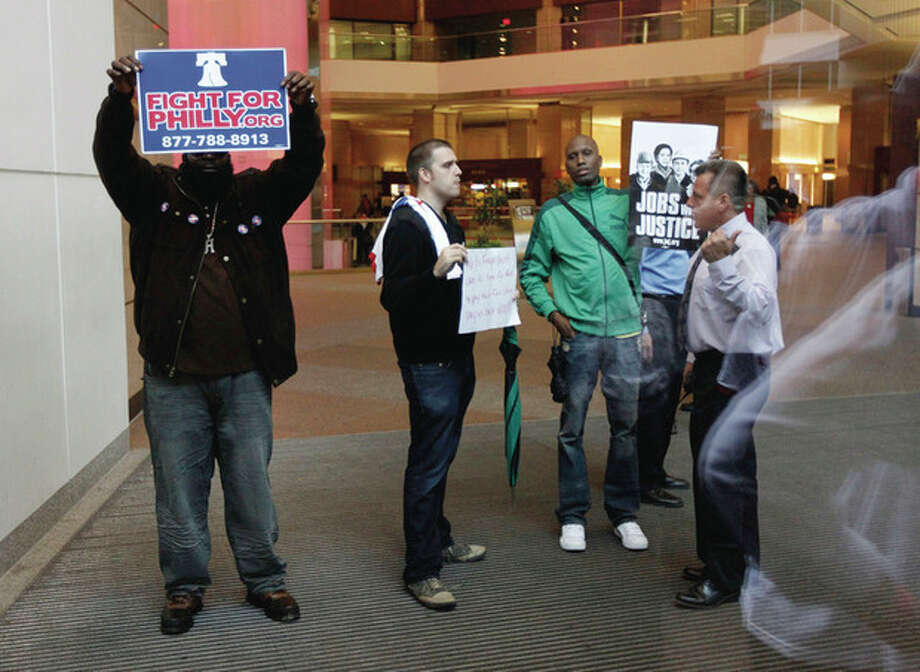 Marchers from the encampment at City Hall are told to leave inside the lobby of a building that houses a Wells Fargo Bank, Thursday, Oct. 13, 2011 in Philadelphia. The encampment at City Hall is one of many being held across the country recently in support of the ongoing Occupy Wall Street demonstration in New York. (AP Photo/Alex Brandon) / AP