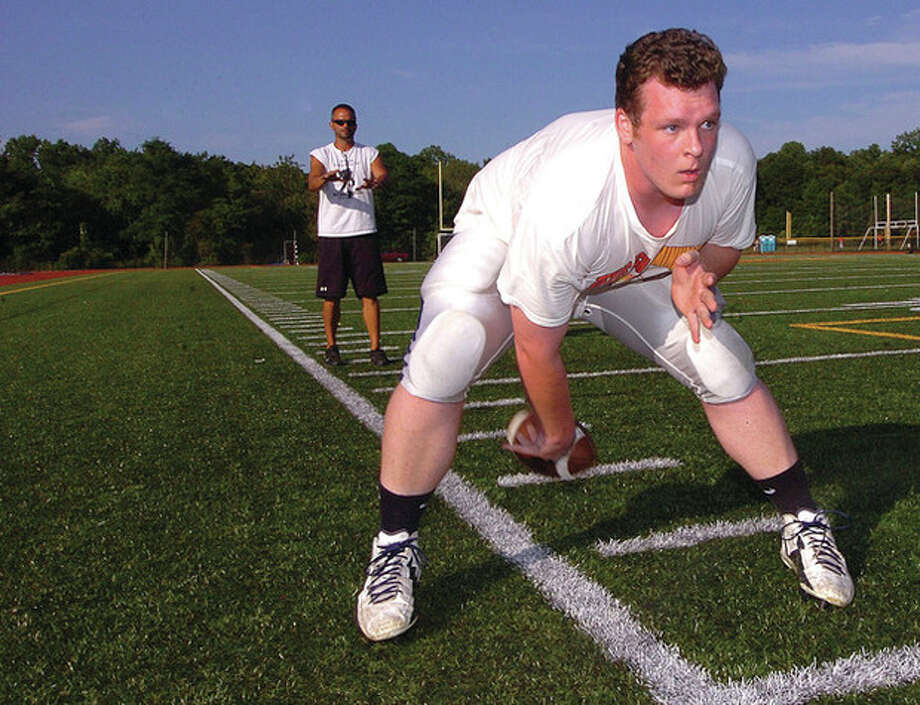 Hour Photo/ Alex von Kleydorff. Hunter Geraghty at Football camp in Trumbull / 2012 The Hour Newspapers