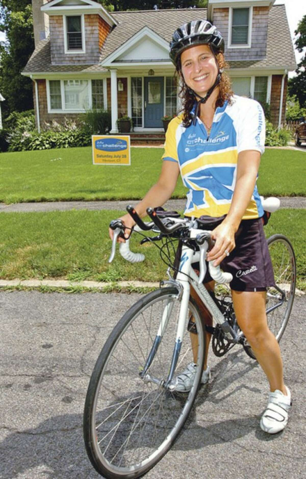Aimee Elsner is going to participate in the CT Challenge bike ride on July 28 to benefit local programs for cancer patients. Elsner was diagnosed with stage 2 breast cancer in 2009, and has endured four surgeries, as well as chemotherapy and radiation. Since her last surgery in 2010, she has completed four triathlons. Photo by Erik Trautmann