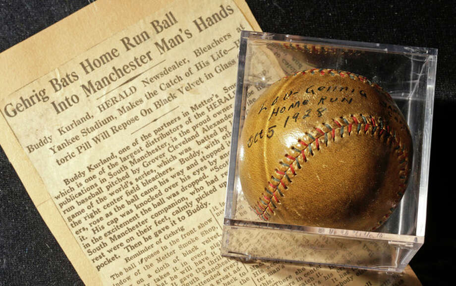 A baseball that New York Yankees slugger Lou Gehrig hit for a World Series home run in 1928 is on display at a convention center in Kansas City, Mo., Thursday, July 5, 2012. Stamford, Conn., resident Elizabeth Gott, is selling the baseball at auction on behalf of her 30-year-old son, Michael to help pay off his medical school debts. (AP Photo/Charlie Riedel) / AP
