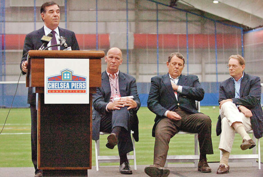 Stamford mayor Michael Pavia speaks during the grand opening ceremonies at the New Chelsea Piers CT in Stamford Thursday.Hour photo / Erik Trautmann / (C)2012, The Hour Newspapers, all rights reserved