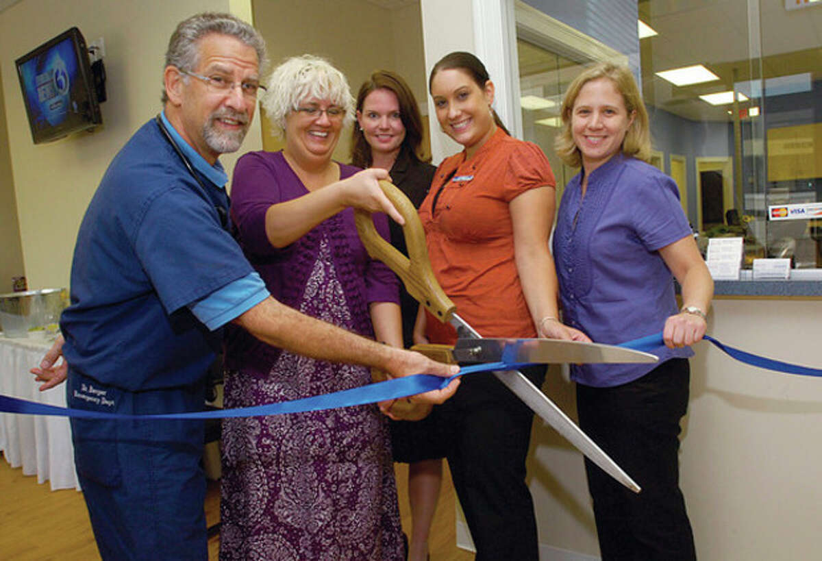 Hour photo / Erik Trautmann Dr. Steven Berger, Beth Agen, Director Lindsey Rocha, CEO Linda RohatSch and Dr. Cynthia Vanson take part in the grand opening ribbon cutting of the Urgent Care of Norwalk's new home at 346 Main Ave., the former address of The Hour.