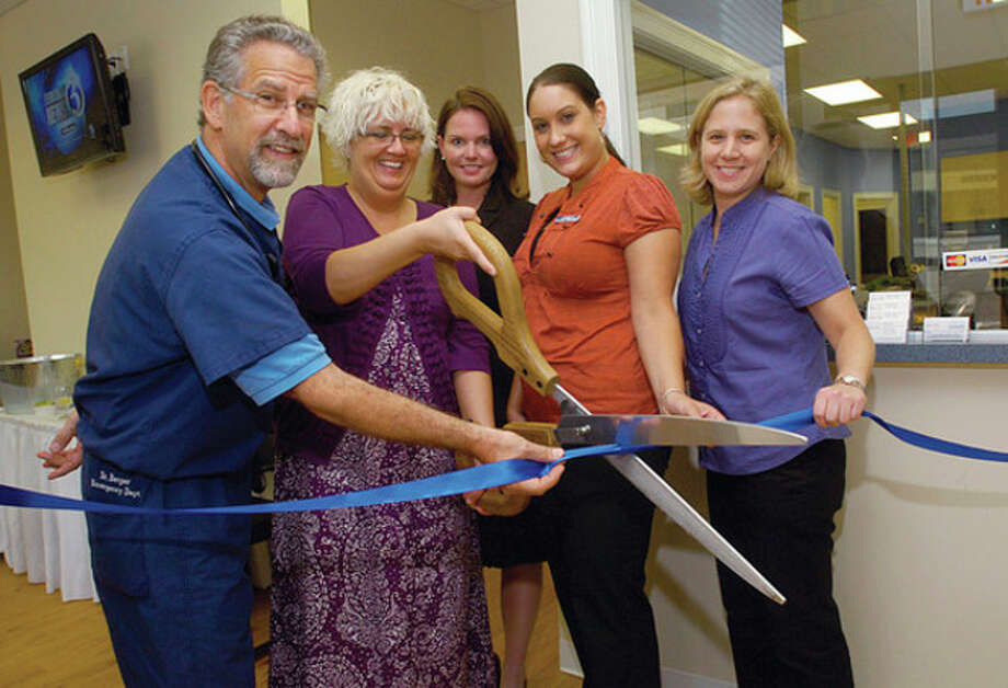 Hour photo / Erik Trautmann Dr. Steven Berger, Beth Agen, Director Lindsey Rocha, CEO Linda RohatSch and Dr. Cynthia Vanson take part in the grand opening ribbon cutting of the Urgent Care of Norwalk's new home at 346 Main Ave., the former address of The Hour. / (C)2011, The Hour Newspapers, all rights reserved