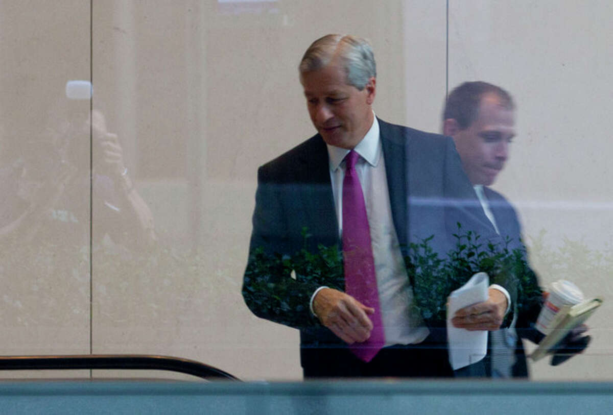 JPMorgan Chase CEO Jamie Dimon enter the company's headquarters in New York Friday, July 13, 2012. JPMorgan Chase, the largest bank in the United States, said Friday that its loss from a highly publicized trading blunder had grown to $4.4 billion in the most recent quarter, more than double the bank's original estimate of $2 billion. (AP Photo/Jin Lee)