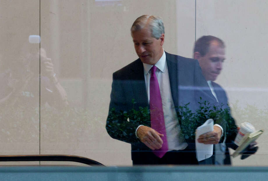 JPMorgan Chase CEO Jamie Dimon enter the company's headquarters in New York Friday, July 13, 2012. JPMorgan Chase, the largest bank in the United States, said Friday that its loss from a highly publicized trading blunder had grown to $4.4 billion in the most recent quarter, more than double the bank's original estimate of $2 billion. (AP Photo/Jin Lee) / FR159730 AP