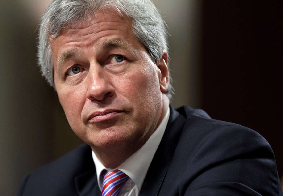 FILE- In this Wednesday, June 13, 2012, file photo, JPMorgan Chase CEO Jamie Dimon, head of the largest bank in the United States, testifies before the Senate Banking Committee on Capitol Hill in Washington. All eyes will be on JPMorgan Chase on Friday, when it becomes the first U.S. bank to report financial results for April through June. The $2 billion trading loss by the largest U.S. bank rattled the company's stock price, triggered a U.S. government investigation and hurt both its reputation and that of CEO Jamie Dimon. (AP Photo/J. Scott Applewhite, File)