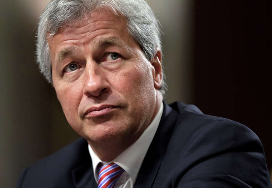 FILE- In this Wednesday, June 13, 2012, file photo, JPMorgan Chase CEO Jamie Dimon, head of the largest bank in the United States, testifies before the Senate Banking Committee on Capitol Hill in Washington. All eyes will be on JPMorgan Chase on Friday, when it becomes the first U.S. bank to report financial results for April through June. The $2 billion trading loss by the largest U.S. bank rattled the company's stock price, triggered a U.S. government investigation and hurt both its reputation and that of CEO Jamie Dimon. (AP Photo/J. Scott Applewhite, File) / The Associated Press