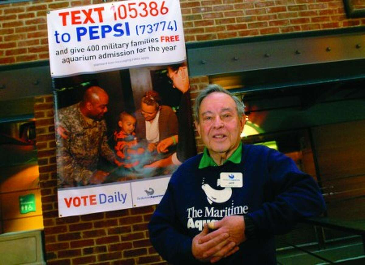 Maritime Aquarium volunteer, Jack Cohen 82, is a Korean War veteran that has spearheaded a grant application that would fund free Maritime Aquarium memberships for military veterans ans their families. hour photo/matthew vinci