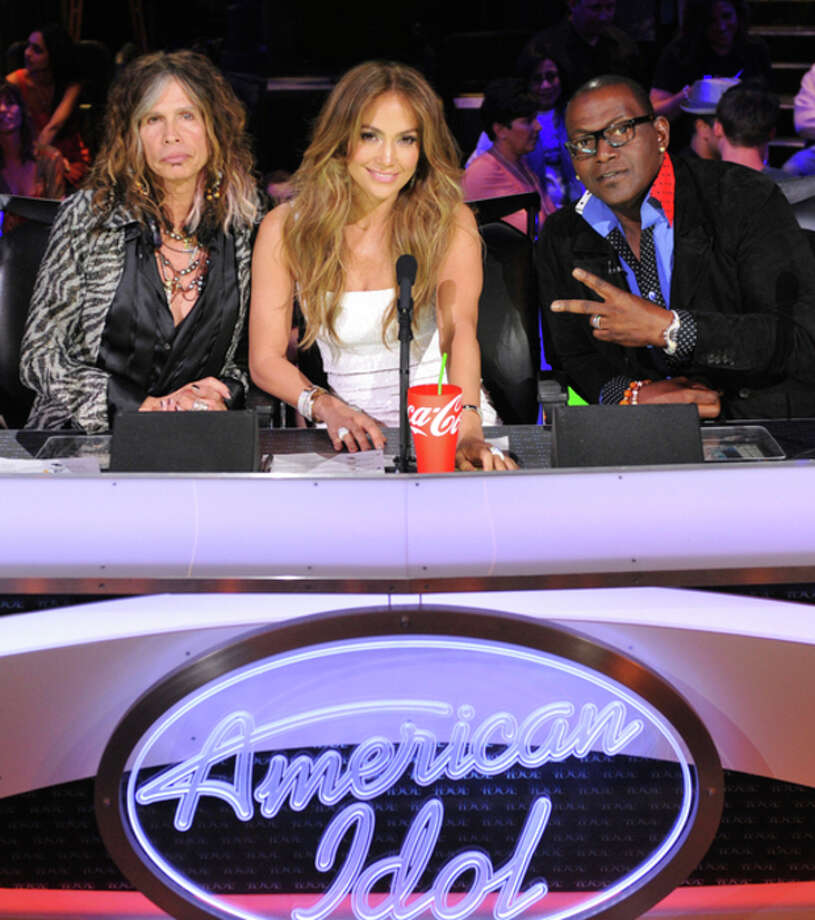 """In this Feb. 28, 2012 photo released by Fox, judges, from left, Steven Tyler, Jennifer Lopez and Randy Jackson are shown on the set of the singing competition series, """"American Idol,"""" in Los Angeles. Tyler announced Thursday, July 12, 2012 that he will not be returning as a judge on the singing competition series """"American Idol."""" Tyler served as a judge with singer/actress Jennifer Lopez and Randy Jackson on the 10th and 11th season of the series. (AP Photo/Fox, Michael Becker, file) / AP2012"""