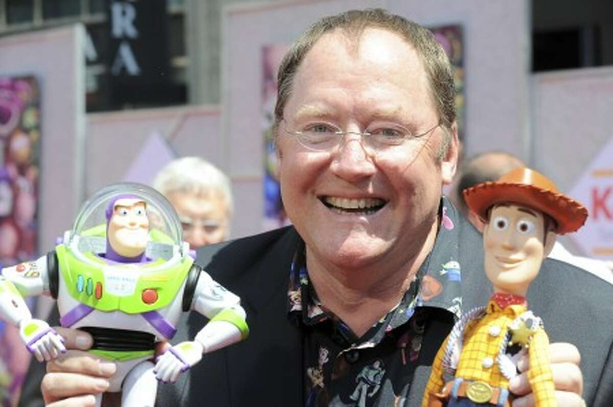 """FILE - In this June 13, 2010 file photo, John Lasseter arrives at the world premiere of """"Toy Story 3,"""" at The El Capitan Theater in Los Angeles. This year half a dozen 360-degree cameras have been set up for the task. Inside each are 11 separate cameras feeding a constant stream of video online. Much of the impetus came from two-time Academy Award-winner John Lasseter, chief creative officer of Walt Disney and Pixar Animation Studios, and a member of the Academy"""