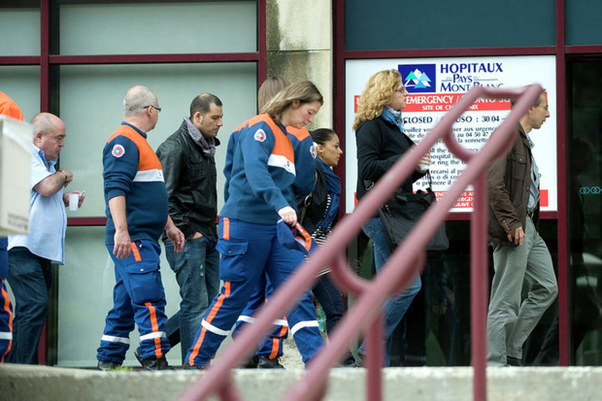 Relatives of the victims of the avalanche enters the hospital near Chamonix, France, Friday, July 13, 2012. An avalanche in the French Alps swept Thursday nine climbers to their deaths on a slope leading to Mont Blanc. Three Britons, three Germans, two Spaniards and a Swiss climber were killed, and 14 people were injured in Thursday's accident below the summit of Western Europe's highest peak. A memorial ceremony is scheduled for Saturday afternoon in the Alpine town of Chamonix. (AP Photo/Massimo Pinca)