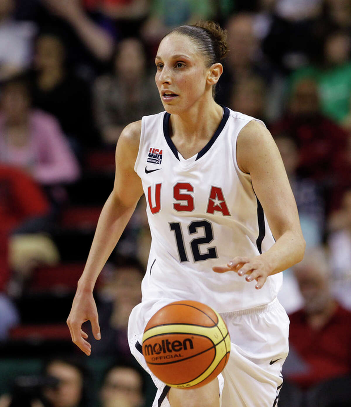 """FILE - In this photo May 12, 2012 file photo, United States' Diana Taurasi competes against China in an exhibition women's basketball game in Seattle. Taurasi has missed the Phoenix Mercury's last 16 games with hip and ankle injuries, but she tells the AP she will be """"ready to go"""" for the Olympics. She will join the U.S. team in Washington this weekend for two days of practice before playing Brazil in an exhibition game. (AP Photo/Elaine Thompson, File)"""