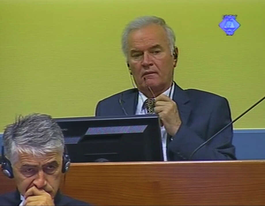 This video image made available by The International Criminal Tribunal for the former Yugoslavia, ICTY, shows former Bosnian Serb military chief Ratko Mladic in the court room in The Hague, Netherlands Monday July 9, 2012. Mladic faces 11 charges of genocide, war crimes and crimes against humanity. He denies wrongdoing. (AP Photo/ICTY VIDEO) / ICYTY