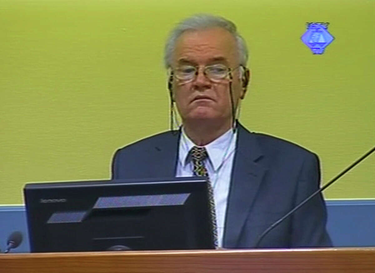 This video image made available by The International Criminal Tribunal for the former Yugoslavia, ICTY, shows former Bosnian Serb military chief Ratko Mladic in the court room in The Hague, Netherlands Monday July 9, 2012. Mladic faces 11 charges of genocide, war crimes and crimes against humanity. He denies wrongdoing. (AP Photo/ICTY VIDEO)