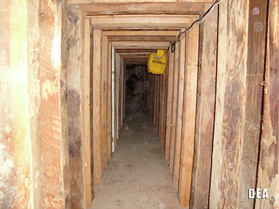 In this undated photo provided by the United States Drug Enforcement Administration, shows a 240-yard, a complete and fully operational drug smuggling tunnel, from the U.S. side of the tunnerl, that ran from a small business in Arizona to an ice plant on the Mexico side of the border, Thursday, July 12, 2012, in San Luis, Ariz.(AP Photo/Drug Enforcement Administration) / Drug Enforcement Administration