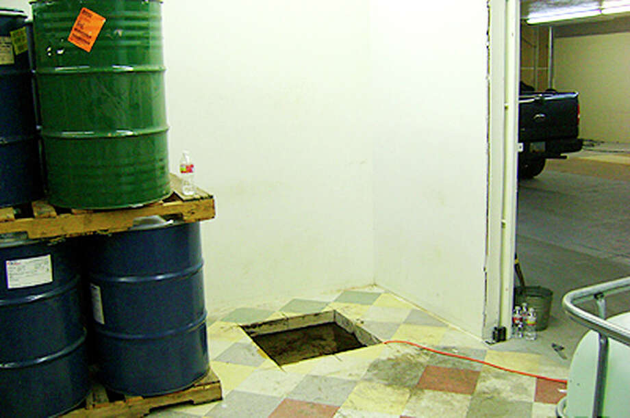 In this undated photo provided by the United States Drug Enforcement Administration, shows floor shaft entrance from a storage room that was a 240-yard, a complete and fully operational drug smuggling tunnel that ran from a small business in Arizona to an ice plant on the Mexico side of the border, Thursday, July 12, 2012, in San Luis, Ariz.(AP Photo/Drug Enforcement Administration) / Drug Enforcement Administration
