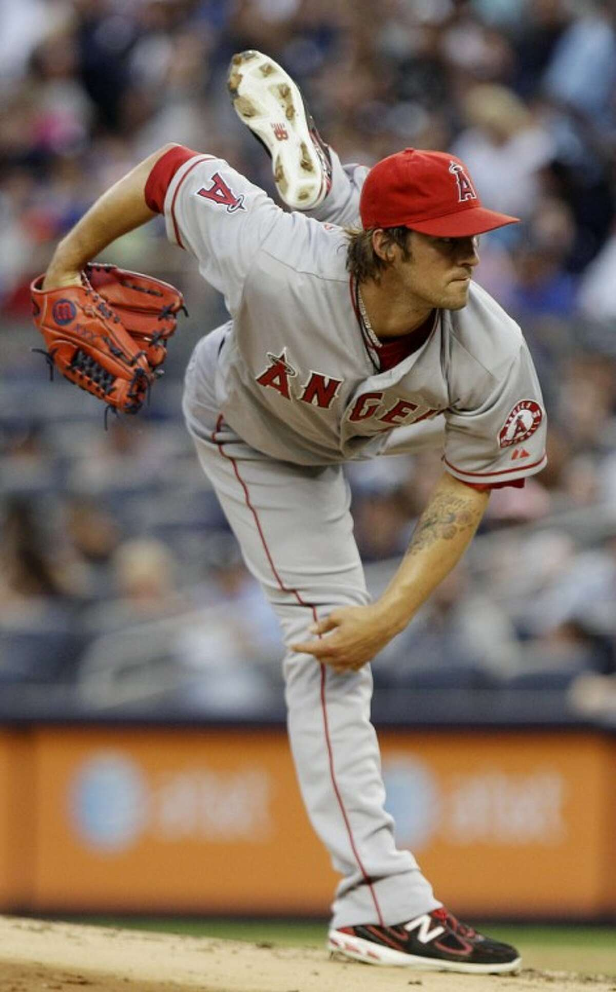 Los Angeles Angels' C.J. Wilson delivers a pitch during the first inning of a baseball game against the New York Yankees, Friday, July 13, 2012, in New York. (AP Photo/Frank Franklin II)
