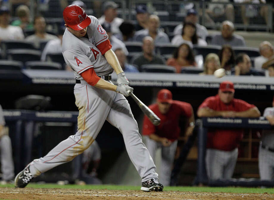 Los Angeles Angels' Mark Trumbo hits a three-run home run during the seventh inning of a baseball game against the New York Yankees, Friday, July 13, 2012, in New York. (AP Photo/Frank Franklin II) / AP