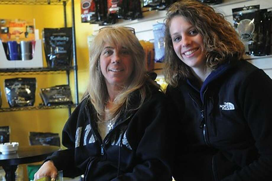 Tracey Scalzi, owner of Tracey''s Smoke Shop & Tabacco comments on the new tax hikes with employee Britttany Kutulski. hour photo/matthew vinci
