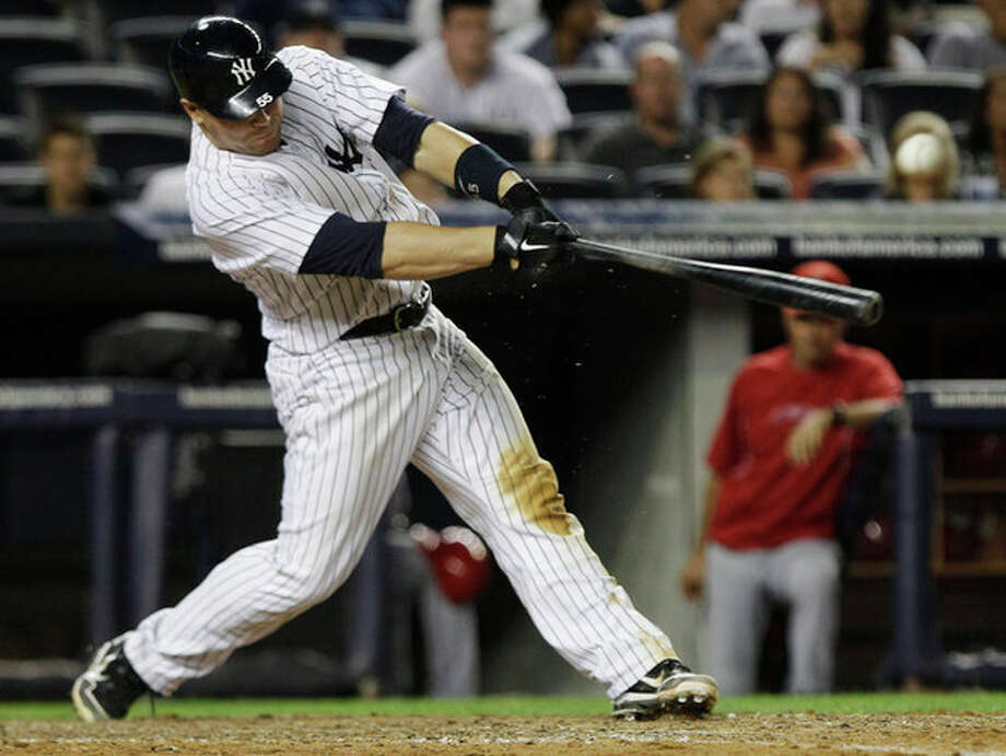 New York Yankees' Russell Martin htis an RBI single during the eighth inning of a baseball game against the Los Angeles Angels, Friday, July 13, 2012, in New York. (AP Photo/Frank Franklin II) / AP