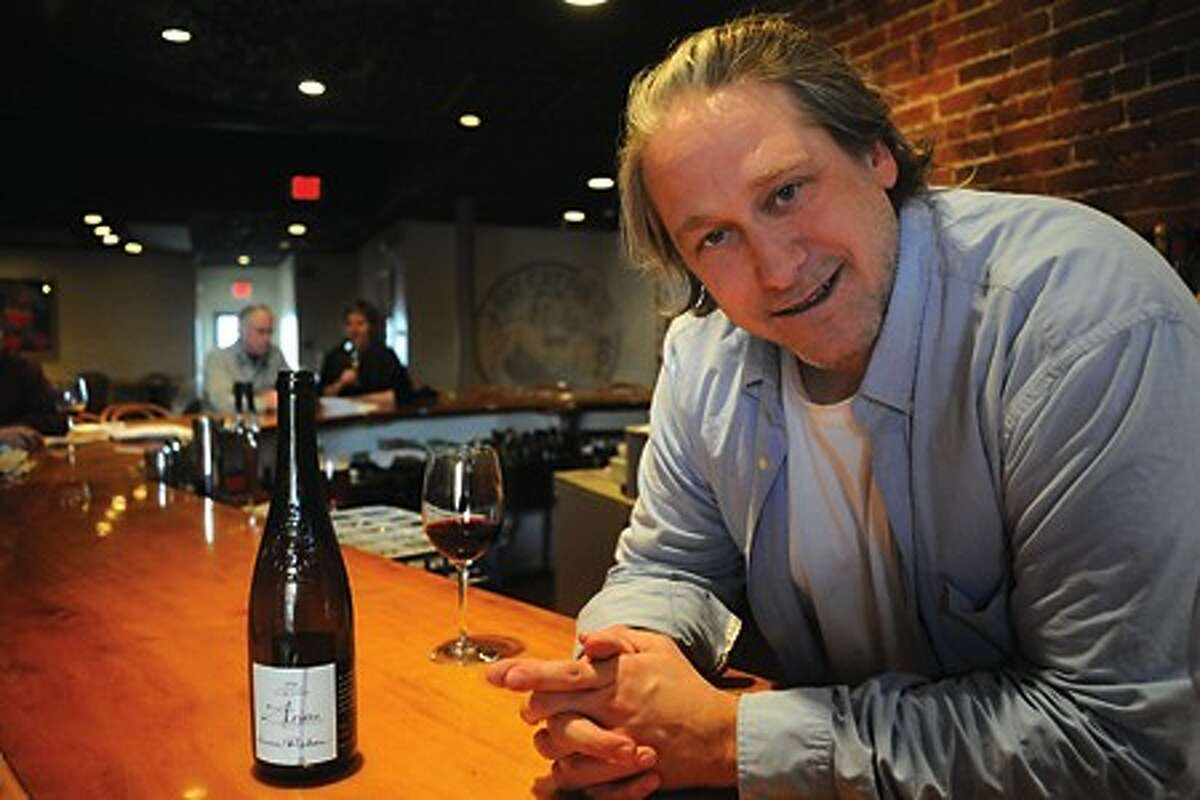 Anthony Ancona, owner of Fat Cat Pie in Norwalk comments on the new tax hikes. hour photo/matthew vinci
