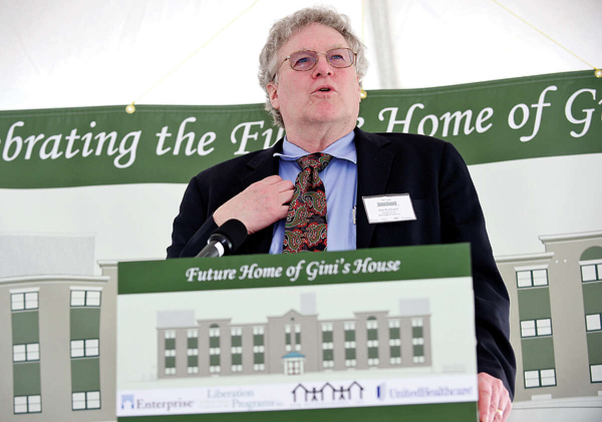 Ross Burkhardt, Presidenta nd CEO of New Neighborhoods joins state and local elected officials in celebrating the beginning of $7.2 million renovation of 4 Elmcrest Terrace into a 18 unit supportive housing development to be called Gini's House during a reception Friday afternoon. Hour photo / Erik Trautmann