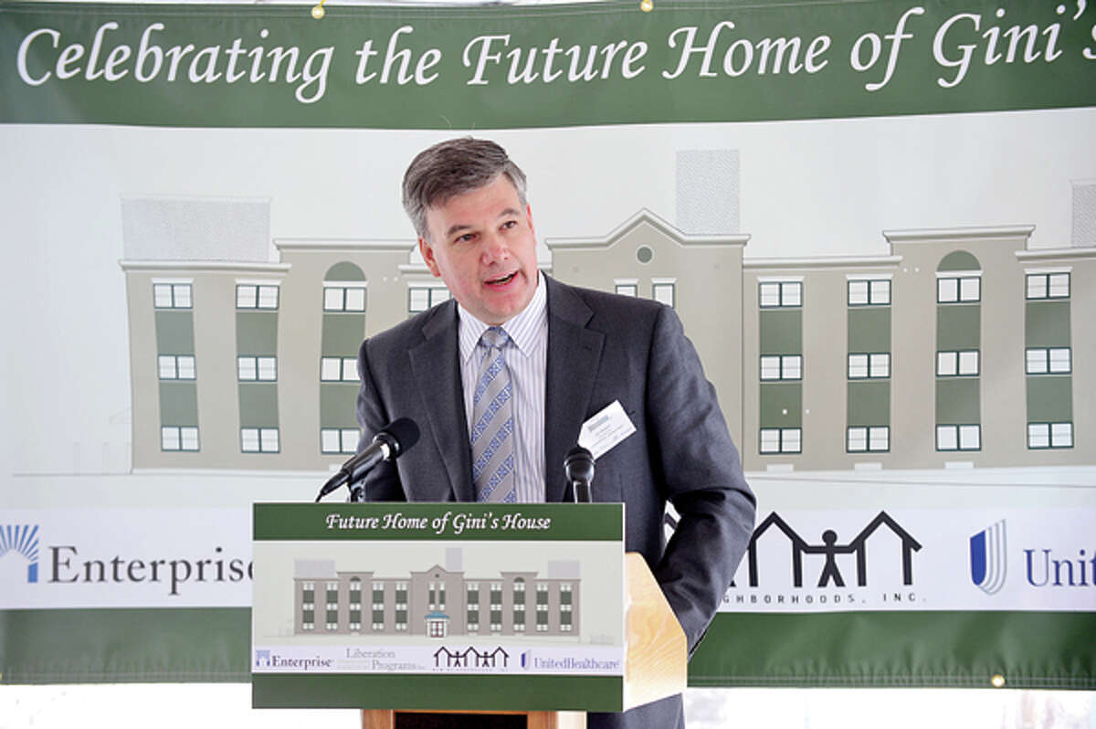 Jim Bedard, CFO and COO of Unitred Healthcare Northeast Region, joins state and local elected officials in celebrating the beginning of $7.2 million renovation of 4 Elmcrest Terrace into a 18 unit supportive housing development to be called Gini's House during a reception Friday afternoon. Hour photo / Erik Trautmann