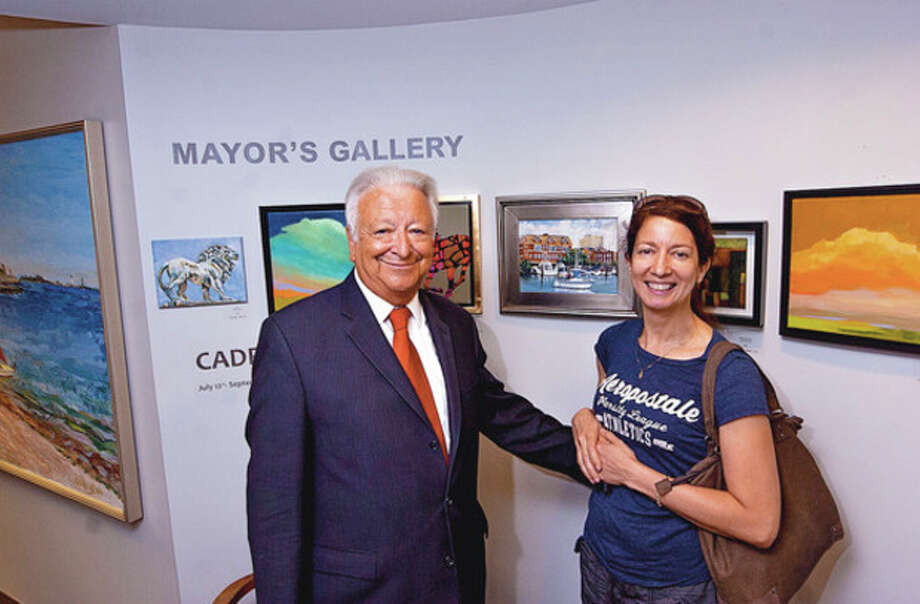 Artist Saida Markovic and Mayor Richard Moccia pose for photos during the opening reception of the Mayor's Gallery Thursday outside the mayor's office.Hour photo / Erik Trautmann / ©2012 The Hour Newspapers