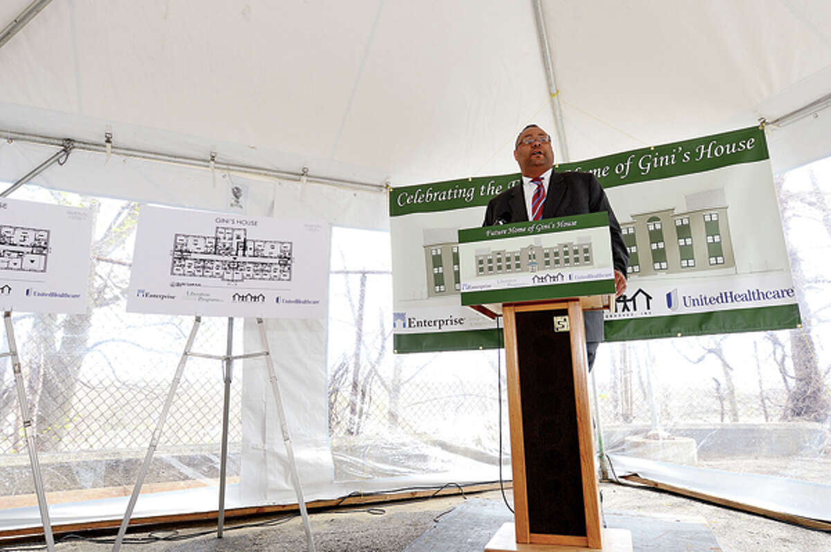 Alan Mathis, President and CEO of Liberation Programs joins state and local elected officials in celebrating the start of $7.2 million renovation of 4 Elmcrest Terrace into a 18 unit supportive housing development to be called Gini's House Friday afternoon. Hour photo / Erik Trautmann