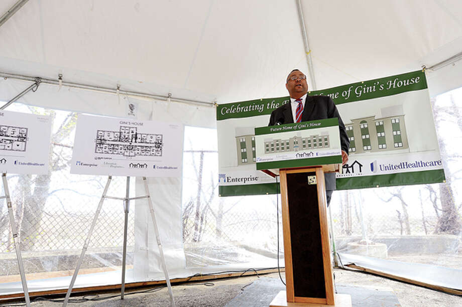 Alan Mathis, President and CEO of Liberation Programs joins state and local elected officials in celebrating the start of $7.2 million renovation of 4 Elmcrest Terrace into a 18 unit supportive housing development to be called Gini's House Friday afternoon. Hour photo / Erik Trautmann / (C)2013, The Hour Newspapers, all rights reserved