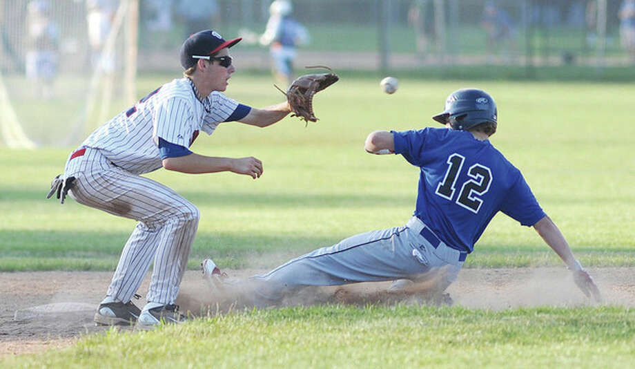 Hour photo/John Nash Wilton Junior Legion shorstop Alex Jacobsen waits for a late throw as Darien-New Canaan baserunner Alex Curto slides safely into second on a failed pick-off attempt. Wilton lost, 4-2.