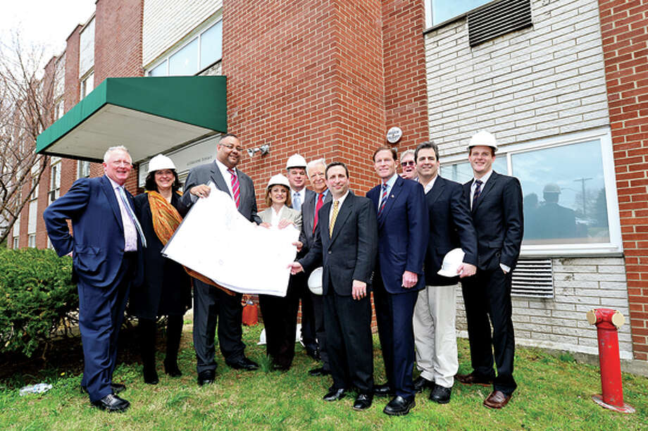 Bob Bantle, Bantle Family, Debra Wallace Hertz, Liberation Programs, Alan Mathis, Liberation Programs, Evonne Klein, CT Dept. of Housing, Jim Bedard, United Healthcare, Norwalk mayor Richard Moccia, Srtate SEnator Bob Duff, US Senator Richard Blumenthal, Ross Burkhardt, New Neighborhoods, State Representative Chris Perone, Sean O'Haga, Enenterprsie Community Investment celebrate the start of $7.2 million renovation of 4 Elmcrest Terrace into a 18 unit supportive housing development to be called Gini's House Friday afternoon. Hour photo / Erik Trautmann / (C)2013, The Hour Newspapers, all rights reserved