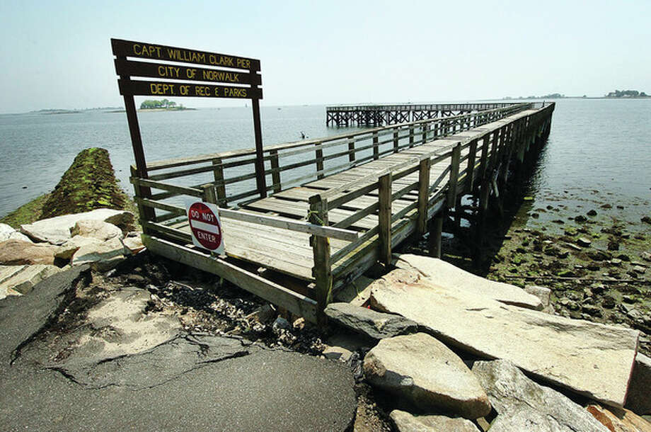 Hour photo / Alex von KleydorffThe Captain William Clark Pier at Calf Pasture Beach. / 2012 The Hour Newspapers