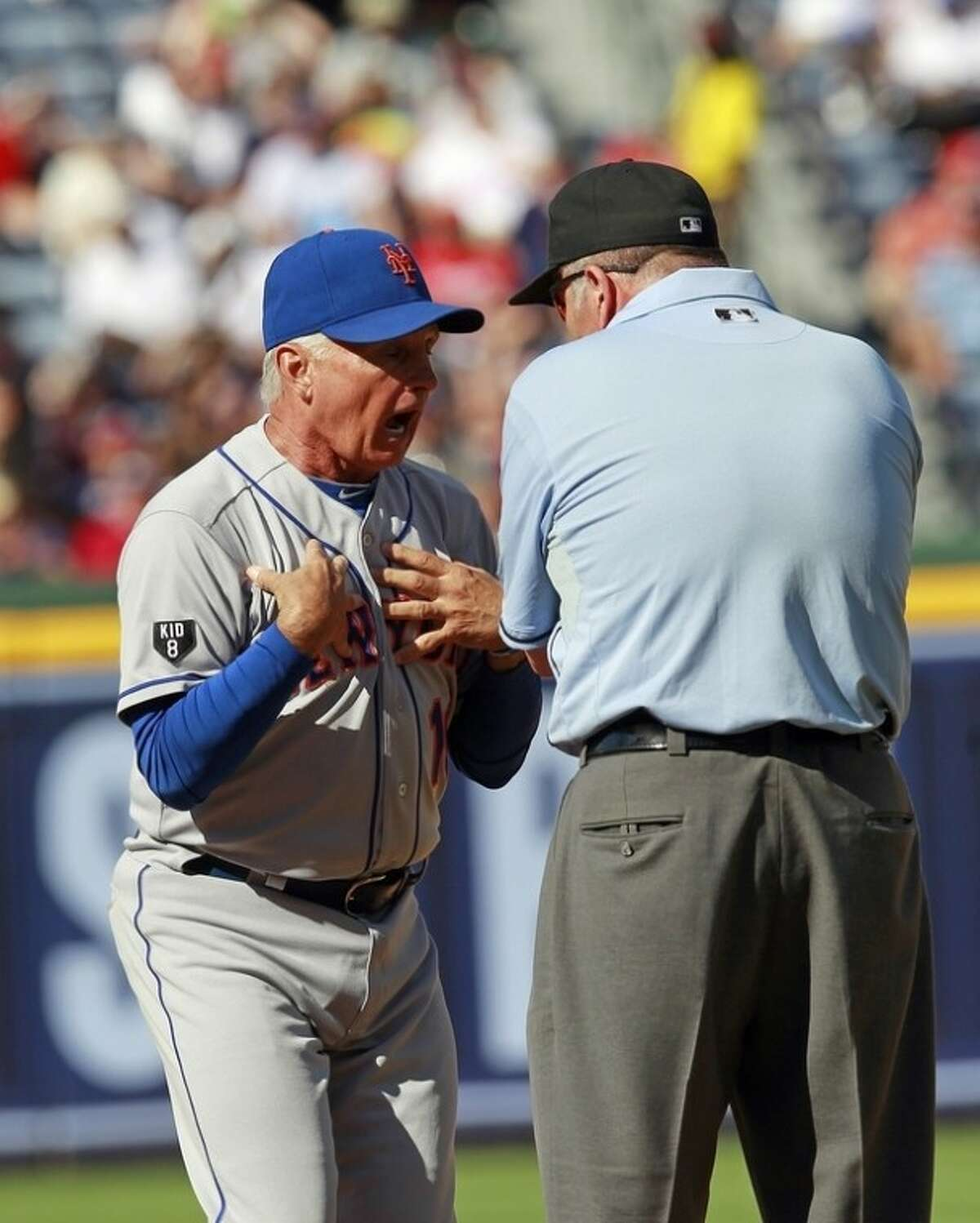 New York Mets manager Terry Collins (10) argues a call on a fly ball with umpire Dale Scott before being ejected from the game in the fifth inning of a baseball game against the Atlanta Braves Saturday, July, 14, 2012 in Atlanta. (AP Photo/John bazemore)