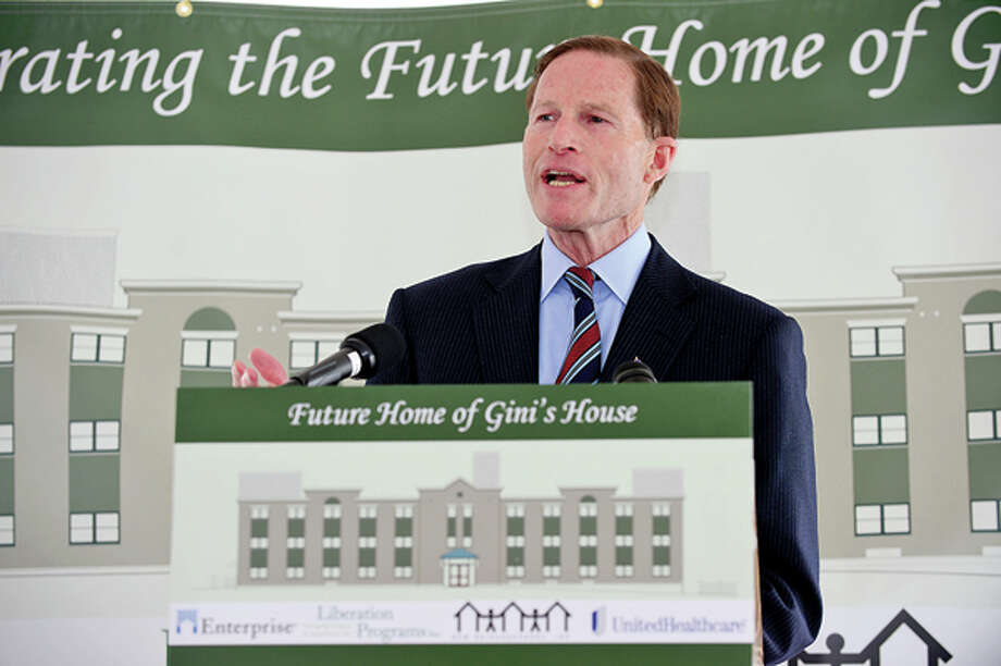 US Senator Richard Blumenthal joins state and local elected officials in celebrating the beginning of $7.2 million renovation of 4 Elmcrest Terrace into an 18 unit supportive housingdevelopment to be called Gini's House during a reception Friday afternoon. Hour photo / Erik Trautmann / (C)2013, The Hour Newspapers, all rights reserved