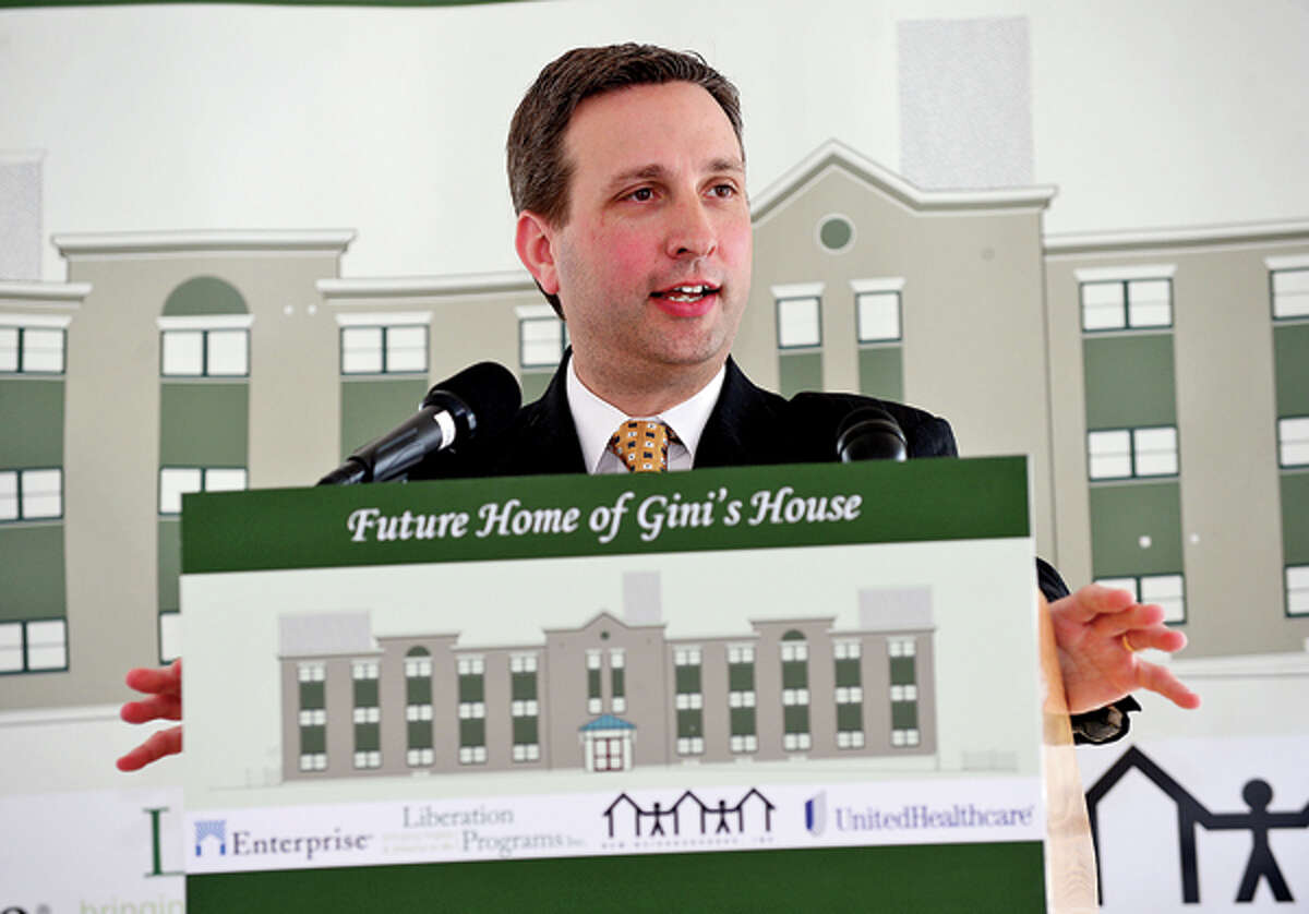 State and local elected officials including State Senator Bob Duff (D-25) celebrate the start of $7.2 million renovation of 4 Elmcrest Terrace into a 18 unit supportive housing development to be called Gini's House during a reception Friday afternoon. Hour photo / Erik Trautmann