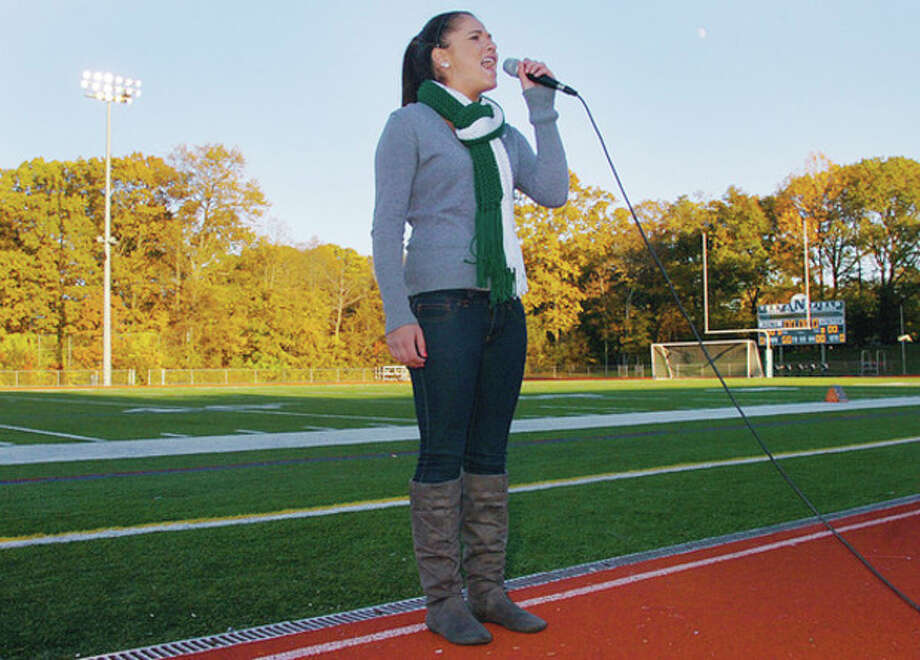 Norwalk High School junior and marimba player for the Marching Bears, Gillian Eckert, sings the Star Spangled Banner to start the 29th annual Calvacade of Bands Saturday at Norwalk High School. Hour photo / Erik Trautmann / (C)2011, The Hour Newspapers, all rights reserved