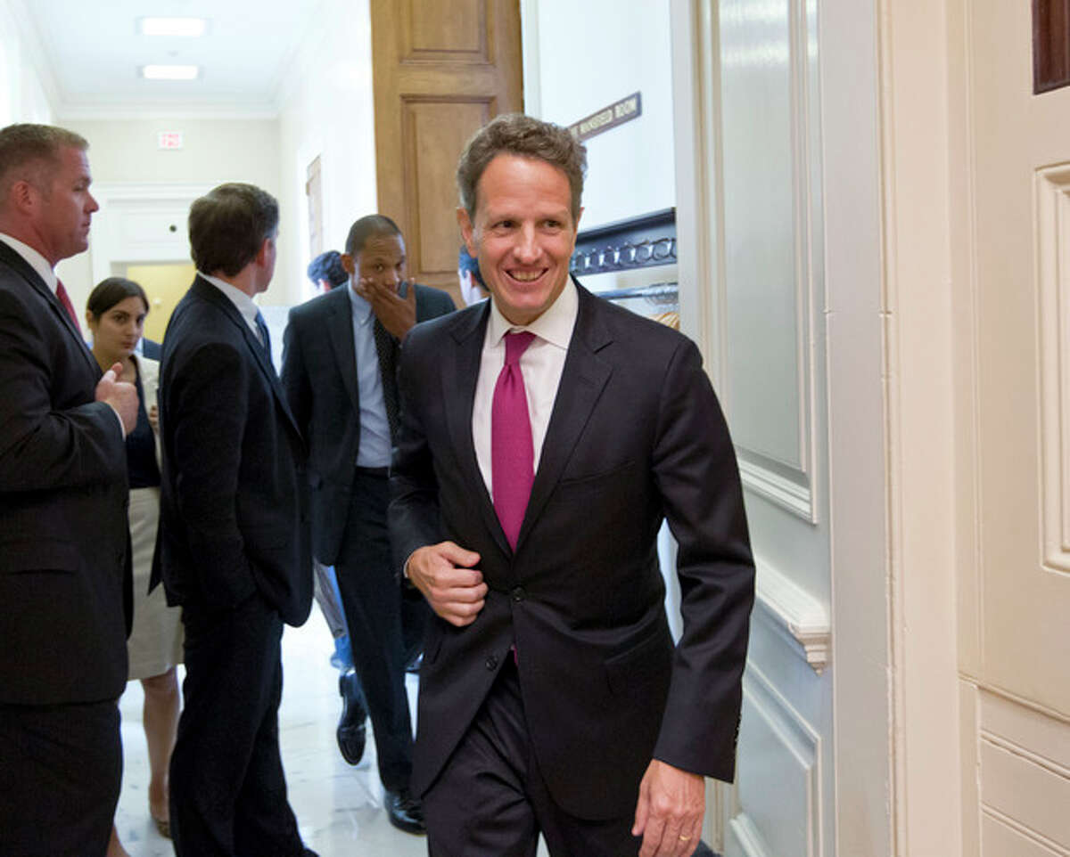 Treasury Secretary Timothy Geithner leaves a closed-door meeting with Senate Democrats on Capitol Hill in Washington, Tuesday, July 10, 2012. Senate Banking Committee Chairman Sen. Tim Johnson, D-S.D. is asking Geithner, as well as Federal Reserve Chairman Ben Bernanke, to be prepared to answer questions at a Congressional hearing later this month about allegations of global interest rate manipulation. (AP Photo/J. Scott Applewhite)
