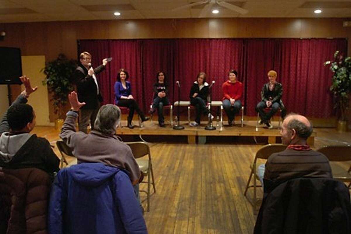 """Emcee Erik Anderson takes an intial vote of the panelists for the Pride Network and St.Paul''s Episcopal Church''s """"Guess the Straight Person"""" event Saturday evening. The event goal was to raise awareness about stereotypes. Hour photo / Erik Trautmann"""
