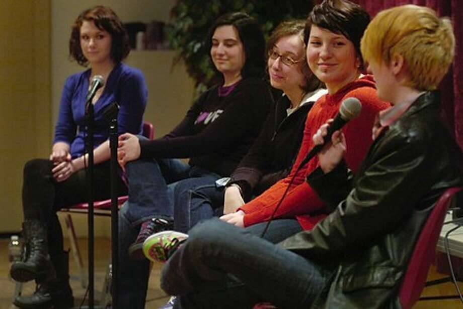 "Panelist for the Pride Network and St.Paul''s Episcopal Church''s ""Guess the Straight Person"" event Saturday evening, Sally Wink, Lisa Tedesco, Sarah Pucci, Elisabeth Crisci and Madeline Abrams answer questions from the audience in an effort to break down stereotypes. Hour photo / Erik Trautmann"