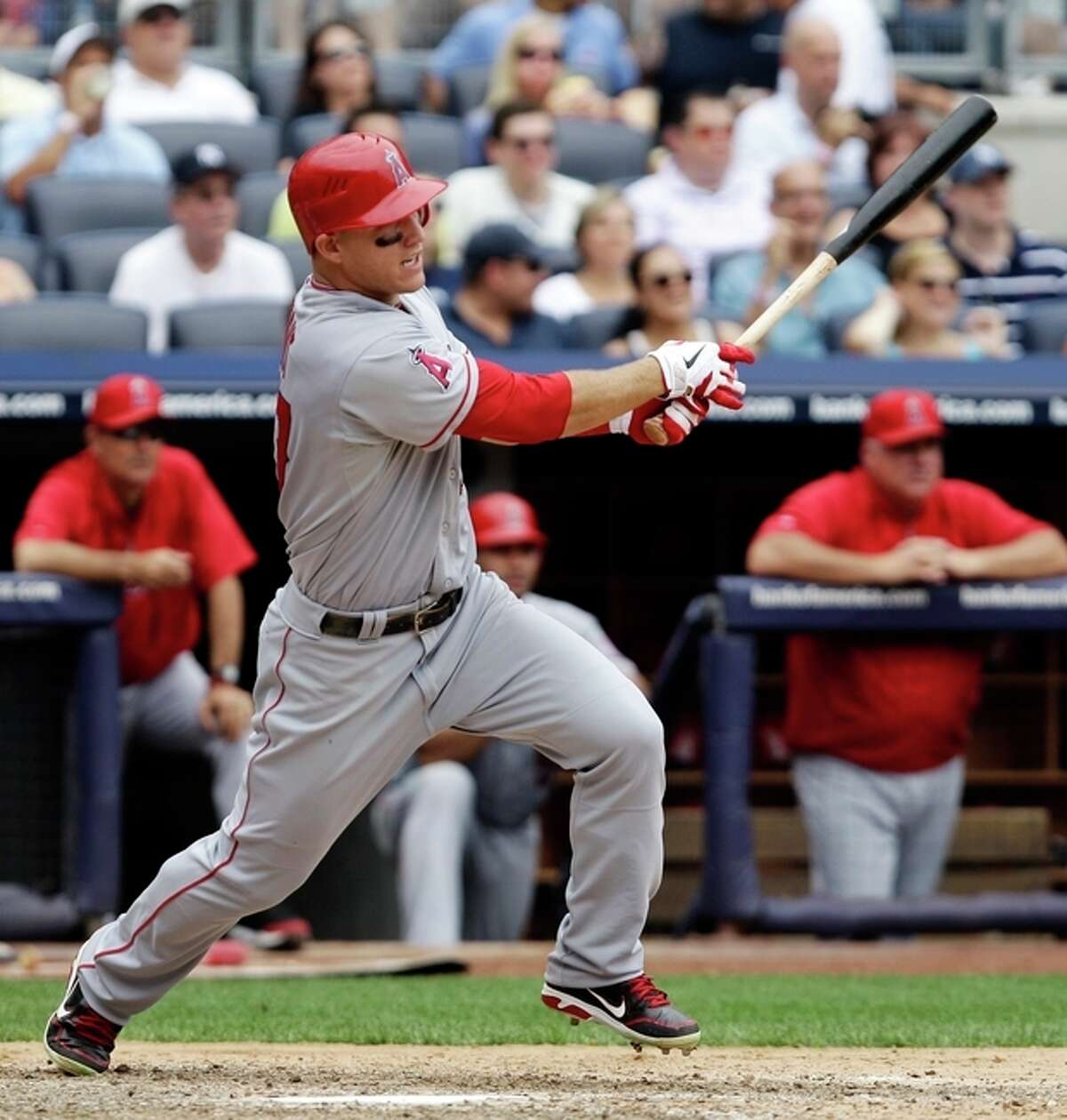 Los Angeles Angels' Mike Trout hits an eighth-inning, RBI double against the New York Yankees during a baseball game at Yankee Stadium in New York, Sunday, July 15, 2012. (AP Photo/Kathy Willens)
