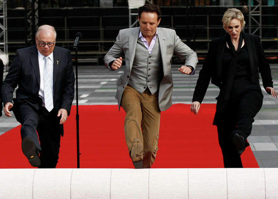 AP photo / Matt Sayles Actress Jane Lynch, right, executive producer Mark Burnett, center, and Academy of Television Arts and Sciences president John Shaffner roll out the red carpet for the 63rd Primetime Emmy Awards in Los Angeles. / AP2011