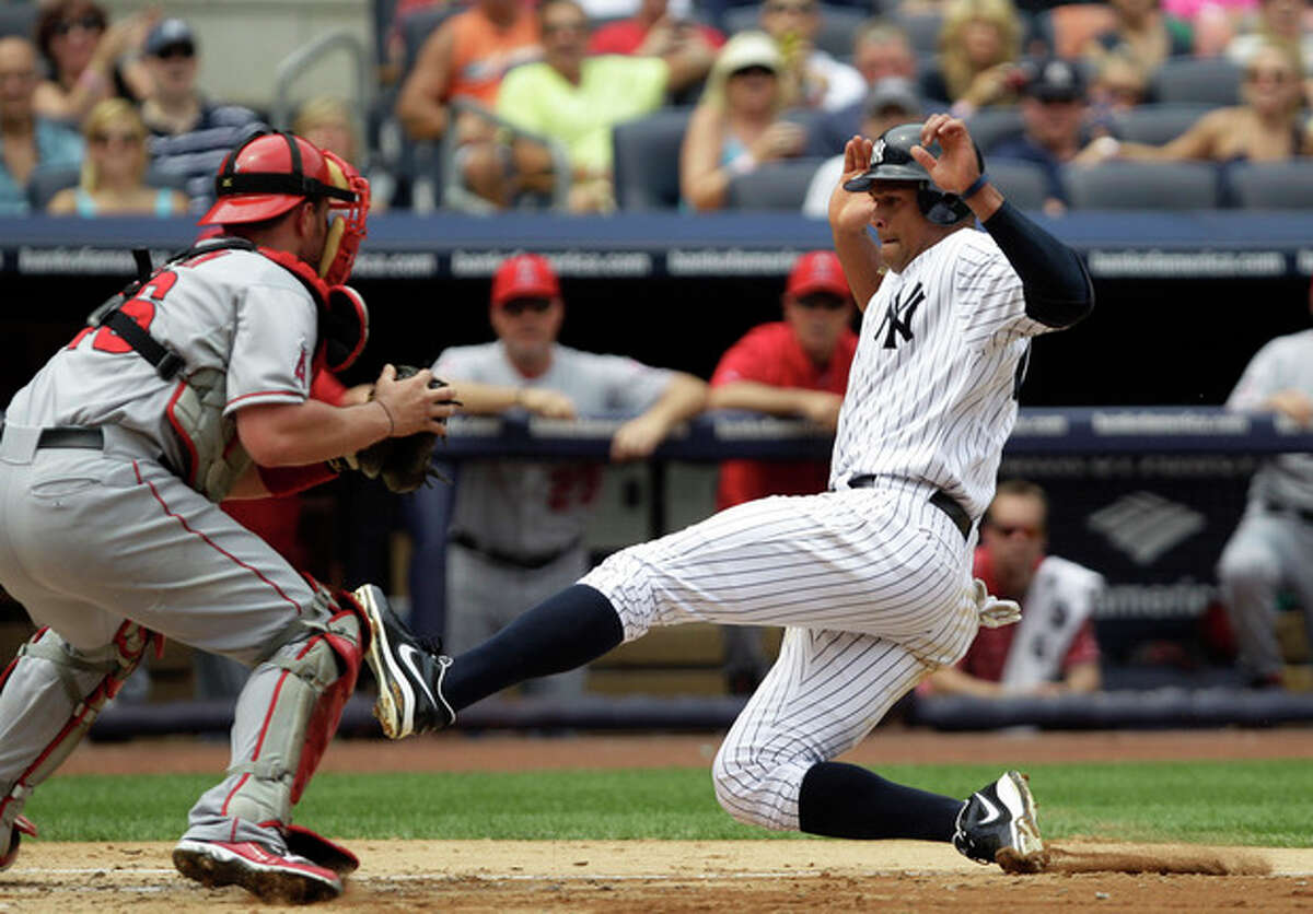 Los Angeles Angels catcher Bobby Wilson catches New York Yankees Alex Rodriguez stealing in a third-inning double play during their baseball game at Yankee Stadium in New York, Sunday, July 15, 2012. (AP Photo/Kathy Willens)