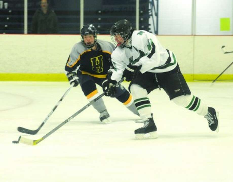 Norwalk -McMahon boys ice hockey #11 Mike McRoy #5 Noah Williams Housatonic-Northwestern. hour photo/matthew vinci